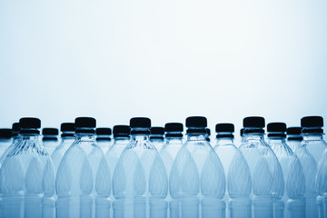 empty plastic bottle silhouettes on blue background