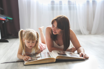 mom and daughter watching together photo album Wall mural
