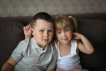 siblings brother and sister watch TV together