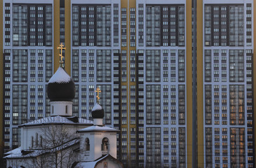 A view shows a church in front of a high-rise apartment building in Saint Petersburg
