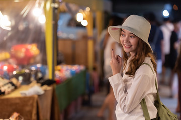 Travel young woman in night street market. Wall mural