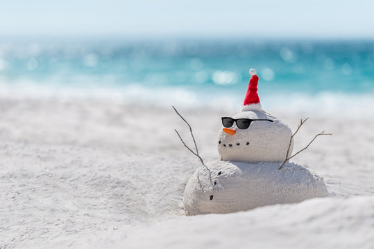 Christmas Sandy Snowman on a beautiful sand beach - Christmas symbol of countries where the weather is always warm