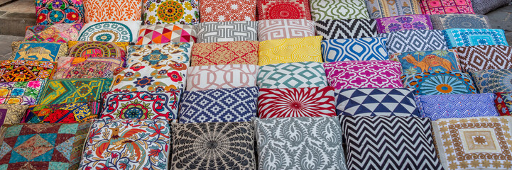 Printed kitchen splashbacks Fabric Colorful cushions and pillows in Dubai souks, United Arab Emirates