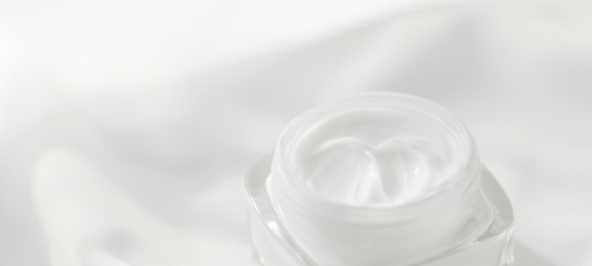 Face cream moisturizer jar on silk background, moisturizing skin care lotion and lifting emulsion, anti-age cosmetics for luxury beauty skincare brand