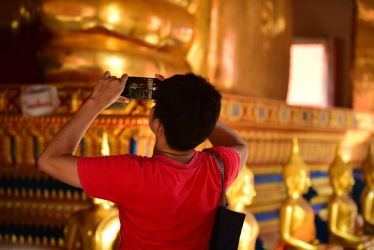 Golden statue of buddha in temple, Thailand