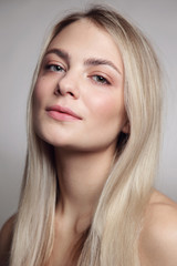 Portrait of young beautiful blonde girl with clean makeup