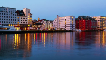 Wall Mural - Bergen, Norway. View of harbour modern buildings in Bergen, Norway during the sunrise. Famous landmarks in the morning. Time-lapse with boats, panning video
