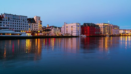 Wall Mural - Bergen, Norway. View of harbour modern buildings in Bergen, Norway during the sunrise. Famous landmarks in the morning. Time-lapse with boats, zoom in