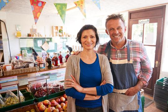 Portrait Of Mature Couple Running Organic Farm Shop Together