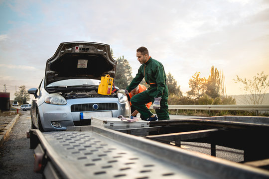 Repairer, transports a broken car on the road.Stock photo