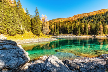 Wall Mural - Amazing mountain lake in autumn time. Europe, Austria,Tyrol, Lake Obernberg, Stubai Alps.