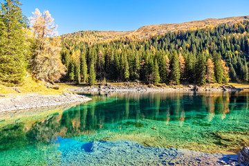 Wall Mural - Sunny Day At Mountain Lake At Autumn Alps. Lake Obernberg is a mountain lake located in the Stubai Alps in Tyrol, Austria.