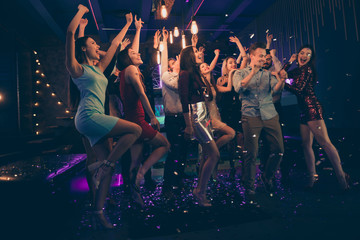 Full length body size photo of cheerful charming beautiful young people having fun at night club...