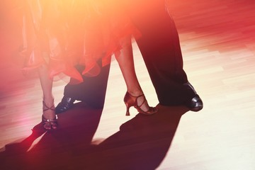 Young man and a woman dancing Salsa