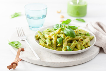 Fototapete - penne pasta with spinach basil pesto sauce