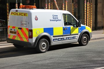 MANCHESTER, UK - APRIL 23, 2013: British Police Crime Scene Investigation vehicle parked in Manchester, UK. The car is Ford Tourneo.