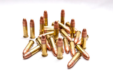 A group of .22 caliber full metal jacket bullets on a white background