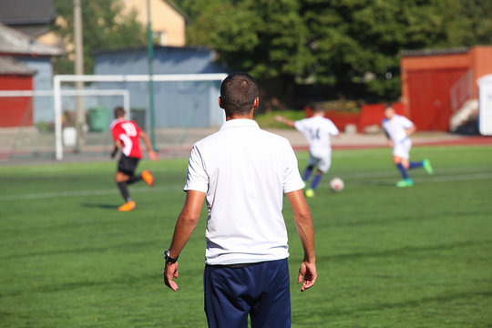 Football coach watching the match