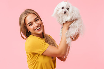 Beautiful lovely girl holding her pet lapdog