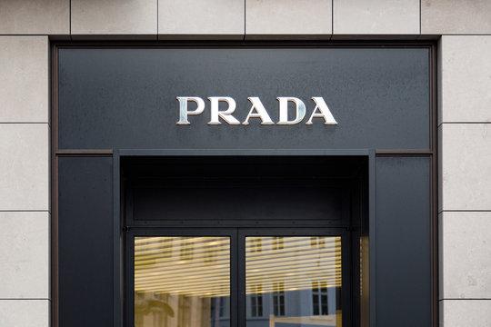 Prada store entrance. Prada brand logo logotype. Prada Italian luxury fashion house.