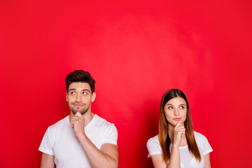 Photo of curious interested planning couple of friends thinking on when sales start touching their chins looking up isolated vivid color in white t-shirt background