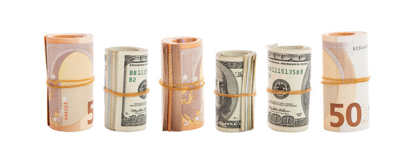 usd and euro banknote rolls isolated against white background.