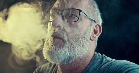 Fotobehang - Man smoking a controversial vape is a health risk