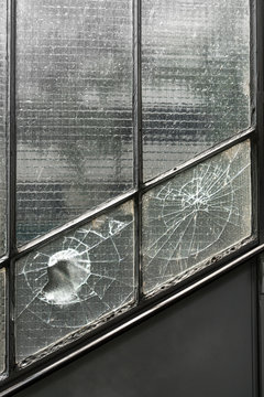 Hole in broken window, abstract background