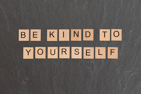 Be Kind To Yourself Written With Game Tiles