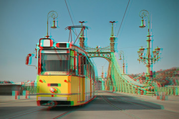 Foto auf Leinwand Budapest Historic tram on Freedom Bridge in Budapest, toned image, 3D anaglyph effect