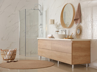 Modern bathroom interior with vessel sink and big mirror