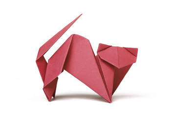 Small red brown origami cat on a white background