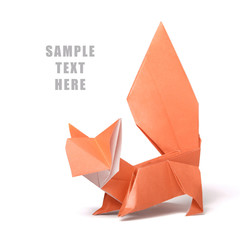 Origami paper orange squirrel on a white