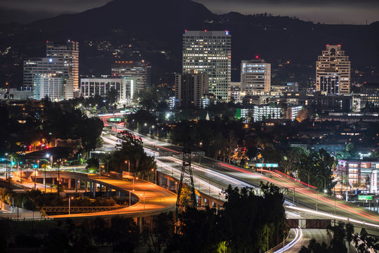 Night view of downtown Glendale office buildings and 134 freeway near Los Angeles in Southern California.