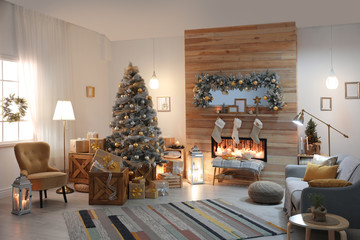 Beautiful living room interior with decorated Christmas tree and fireplace