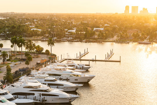 Luxury yacht parked on a canal with the sun coming down at Fort Lauderdale. Port of Fort Lauderdale with Sunset at the marina area