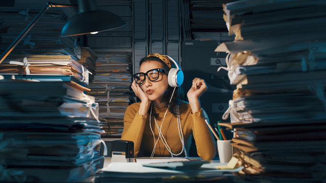 Careless employee listening to music instead of working