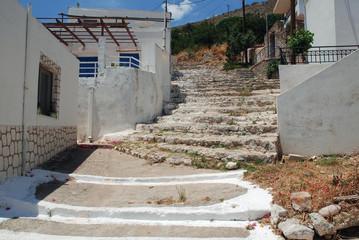 Whitewashed steps leading up through Livadia village on the Greek island of Tilos