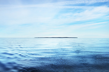 The calm water. A view of the Baltic sea on a sunny summer day. Blue water against the clear sky....