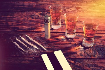 Drugs and alcohol on table.