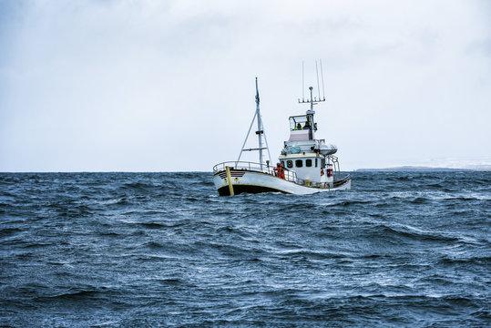 fishing boat in open ocean