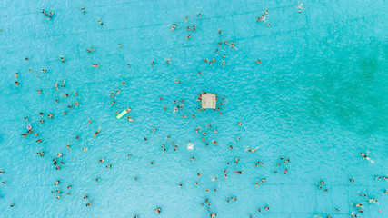 Aerial view of people enjoying the day at public pool, Argentina.