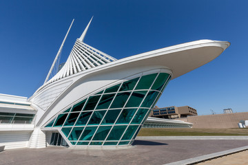 Dramatic view of the front of the Milwaukee Art Museum under a blue sky on April 12, 2018 in Milwaukee, Wisconsin