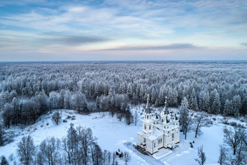 Orthodox church in the winter taiga. Churches of Russia. Smolensk church. Temple near St. Petersburg. Traveling in the North of Russia. Northern nature. White stone monastery. Snowy forest.