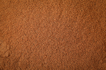 Cinnamon powder textured background. Backdrop for you design