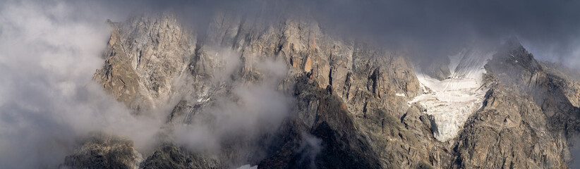 Rocky mountain cliffs in thunderclouds Wall mural