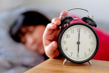 Daylight Saving Time woman waking up