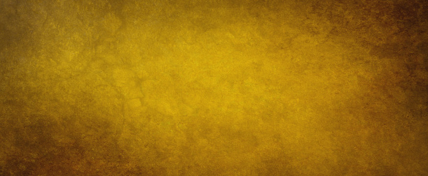 Old brown paper background with texture grain and grunge, distressed gold color with black border