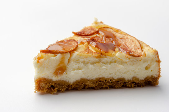 apple Cheesecake with caramel isolated on white background.