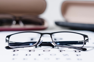 glasses and Eyeglasses on table of check of vision close up - Myopia or hyperopia